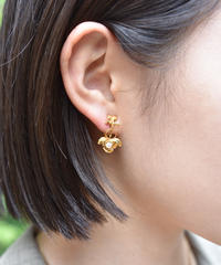 Courreges / AC logo and rose motif clip-on earrings.