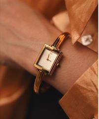 Yves saint laurent/gold bangle logo quartz.