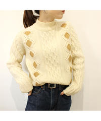 leather patchwork cable sweater