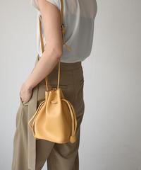 bag2-02506 エコレザーシボ加工  巾着バッグ ブラック ベージュ イエロー