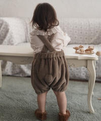 Faux fur suspender shorts with pompom (Wood)