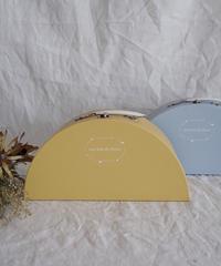 Paper semicircular suitcase yellow