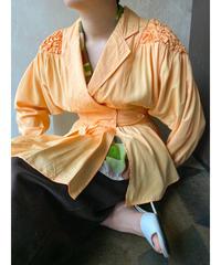 シャーベットオレンジ肩ぽこぽこジャケット
