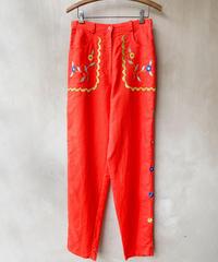 オレンジ刺繍パンツ