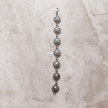 silver sun face bracelet