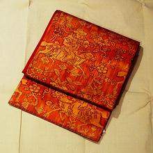 【なごや帯・アウトレット】朱橙色地に人物と花のユニーク柄袋帯