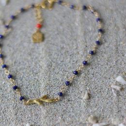 ラピスラズリと珊瑚モチーフのシャンク巻きブレスレット