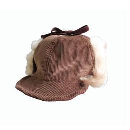INFIELDER DESIGN      PETER CAP - BROWN