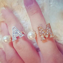 big initial ring (gold color)
