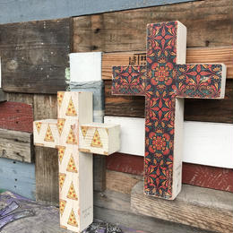 wood cross by sea shore