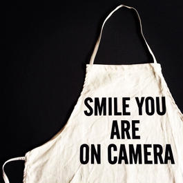 """DRESSSEN ADULT APRON #32 """"SMILE YOU ARE ON CAMERA"""""""