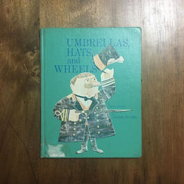 「UMBRELLAS, HATS and WHEELS」Ann Land Jerome Snyder