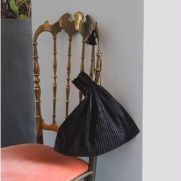 fabric folds tassels ornaments bag