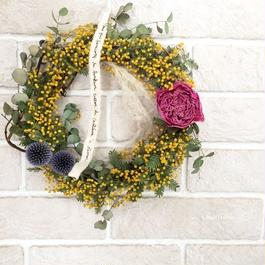 Wreath of mimosa and peony