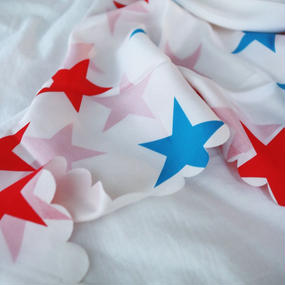 Triangular shaped scarf  with printed  stars