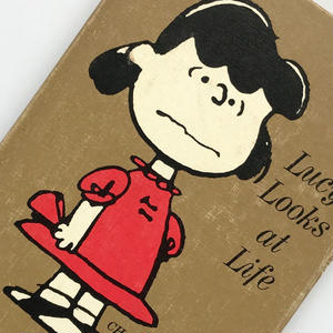 Title/ Lucy Looks at Life  Author/ Charles M.Schulz
