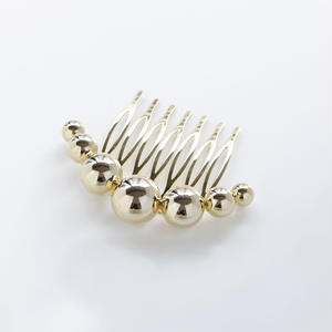 sphere comb / gold