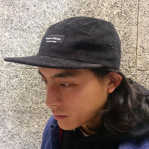 RAISED BY WOLVES CORDUROY CAMP CAP BLACK