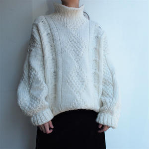 Low gauge white hand knit
