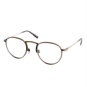OG × OLIVER GOLDSMITH:オージーバイオリバーゴールドスミス《Noun -ノウン col.004 Antique Gold》 眼鏡 ボストン