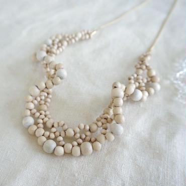jour couture knit necklace