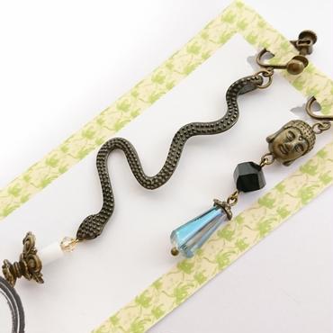 Phantom Jewelry/ファントムジュエリー 蝋燭を衛えた蛇と大仏のイヤリング