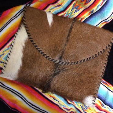 Oversized hide clutch