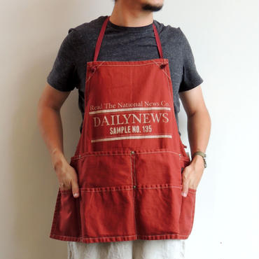 07 NEWSPAPER CO BIB APRON_DARK ORANGE