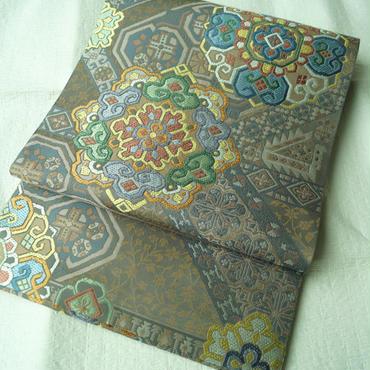 【ふくろ帯】茶色地 更紗文 川島織物製