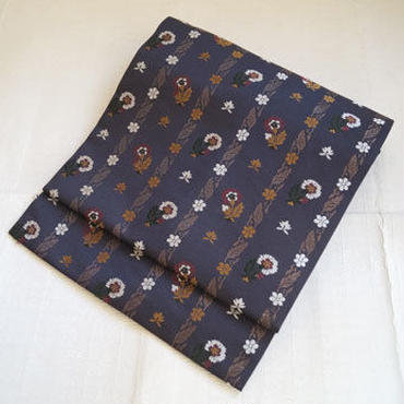 【なごや帯】黒褐色地更紗柄の織りなごや帯