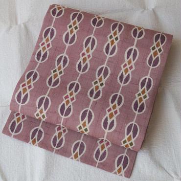 【なごや帯】スモーキーピンク型染め紬地なごや帯