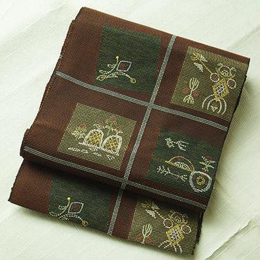 【なごや帯】焦げ茶に象形風八寸なごや帯
