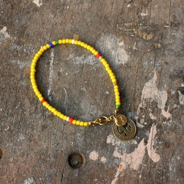Old Beads Bracelet with Vintage Token, Yellow