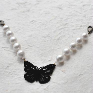 黒い蝶々とコットンパールの羽織紐