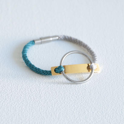 AOM / CIRCLE LINE BRACERET(GOLD LINE/Silver gray×Peacock Blue)