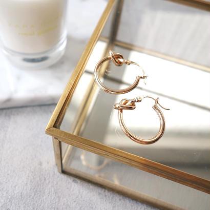 knot hoop pierce