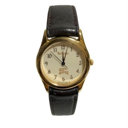 Burberry gold flame logo watch
