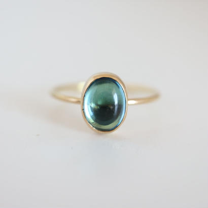 K18  BLUETOPAZ OVAL CABOCHON RING