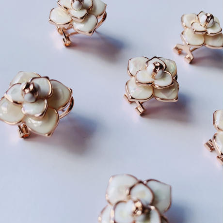 white flower  pink gold pierce