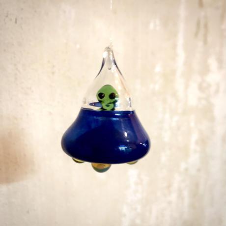 Alien riding a UFO