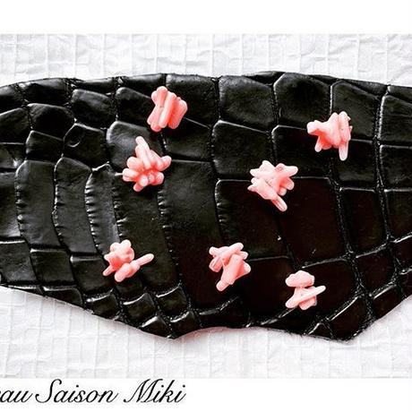 Black crocodile leather necklace with a pink coral