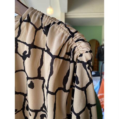 beige design one-piece