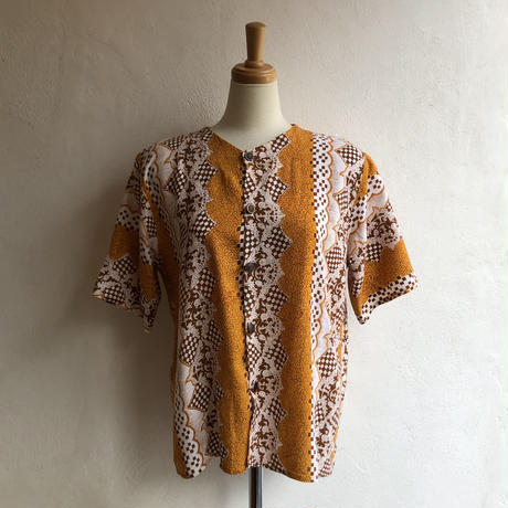 lady's patterned colourless  blouse