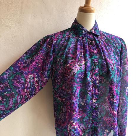 lady's  purple&green patterned blouse