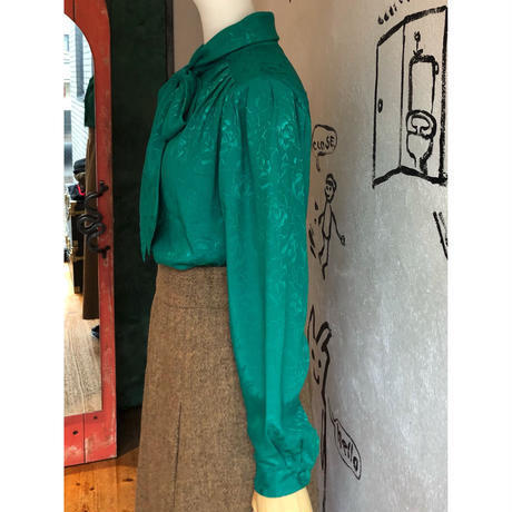 lady's green color bow-tie blouse