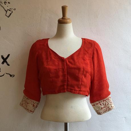 lady's orange color short length oriental tops