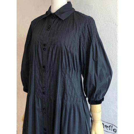 lady's black color tuck design one-piece