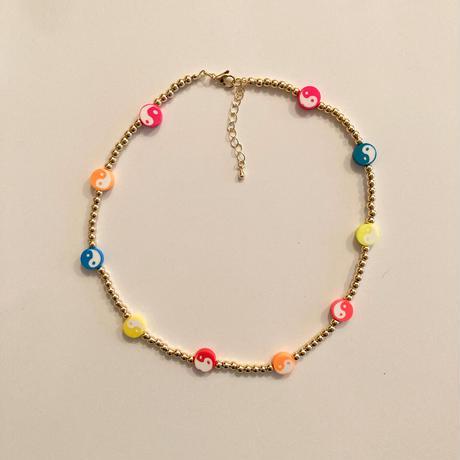 Yin yang gold beaded necklace
