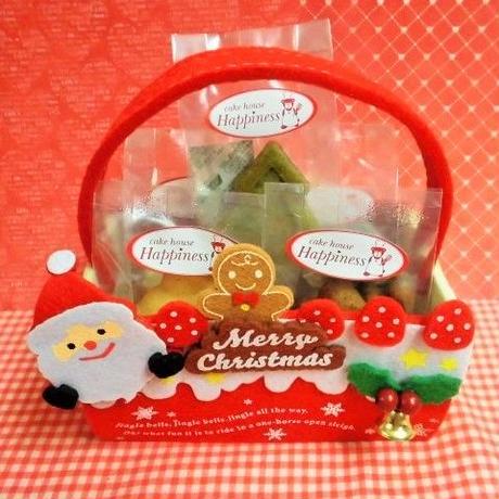 フエルト製サンタさん付きロールケーキ型ケースに焼き菓子5種入り♪(*^▽^*)