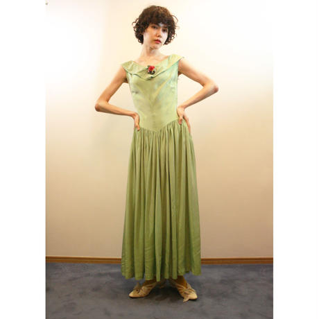 1950s green satin dress with plastic flowers